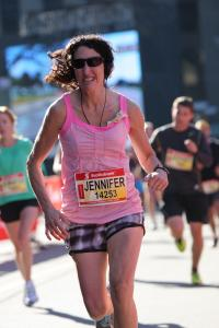 Jennifer racing the Soctiabank Waterfront Half Marathon in Oct 2013 - in 1 hour 36 minutes!