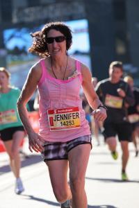 Jennifer racing the Soctiabank Waterfront Half Marathon in Oct 2013 - in 1 hour 36 minutes!